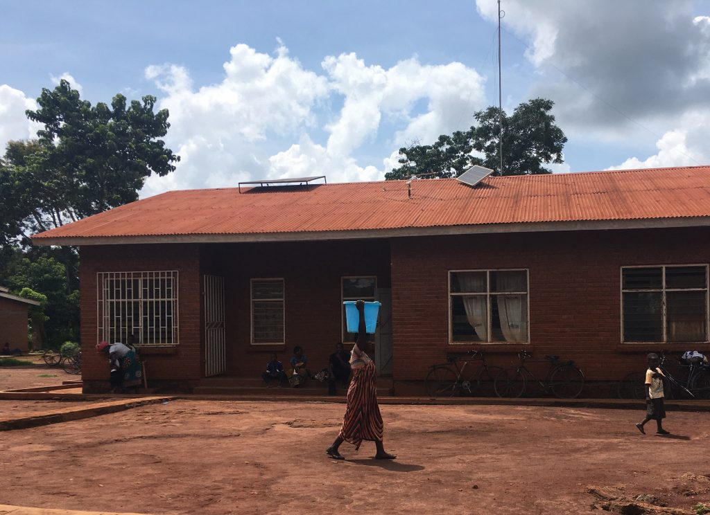 Two solar panels on the roof of a health clinic in Malawi